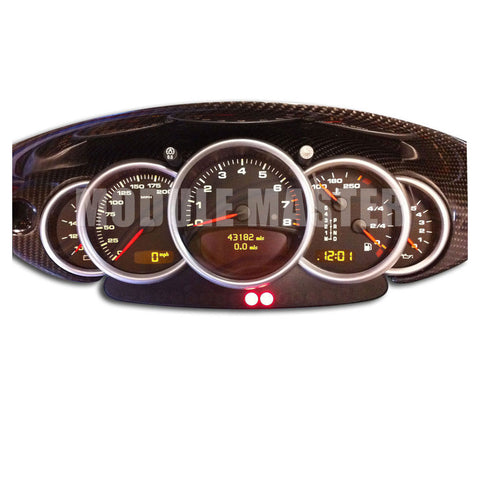 Porsche Instrument Cluster that is powered on with multiple gauges and screens.