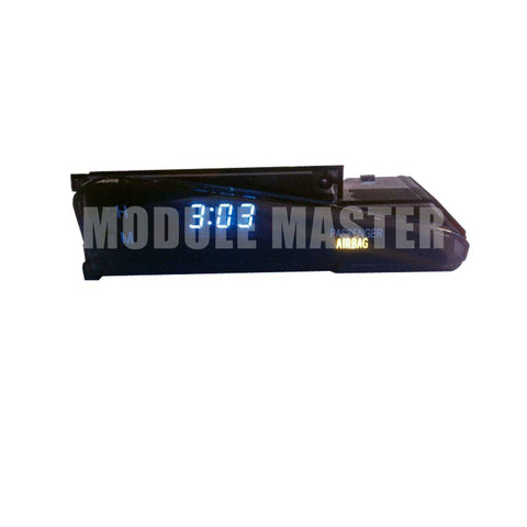Toyota Matrix Clock with airbag light.