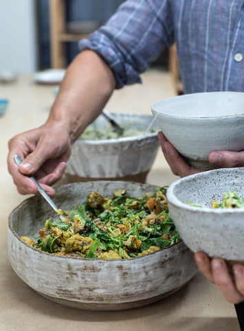 Plant-based food in handmade pottery