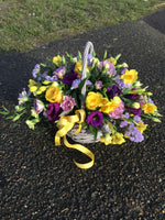 Delicate lemon and lilac basket arrangement