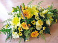Bright sunshine yellow basket , flowers choices are seasonal  PICTURE SHOWN THE MEDIUM SIZE. Please state colur when ordering