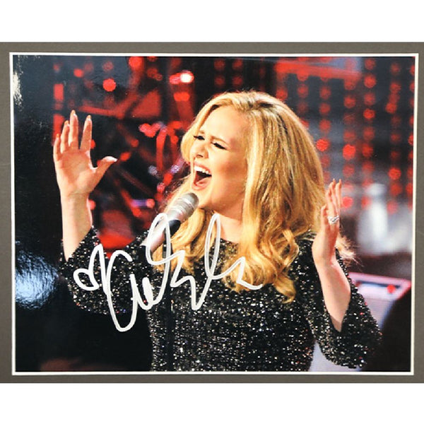 Adele Mounted Colour Photo Personally Signed. This item was signed in person and by hand and was supplied by one of the UK's most respected music memorabilia dealers and a member of both AFTAL & UACC (the most prestigious two trade dealer associations in the World). Comes supplied with a Certificate of Authenticity and a Lifetime Guarantee.