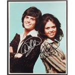 Donny & Marie Osmond Mounted Colour Photo Personally Signed. This item was signed in person and by hand and was supplied by one of the UK's most respected music memorabilia dealers and a member of both AFTAL & UACC (the most prestigious two trade dealer associations in the World). Comes supplied with a Certificate of Authenticity and a Lifetime Guarantee.