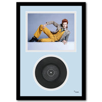 Framed David Bowie vinyl and picture.