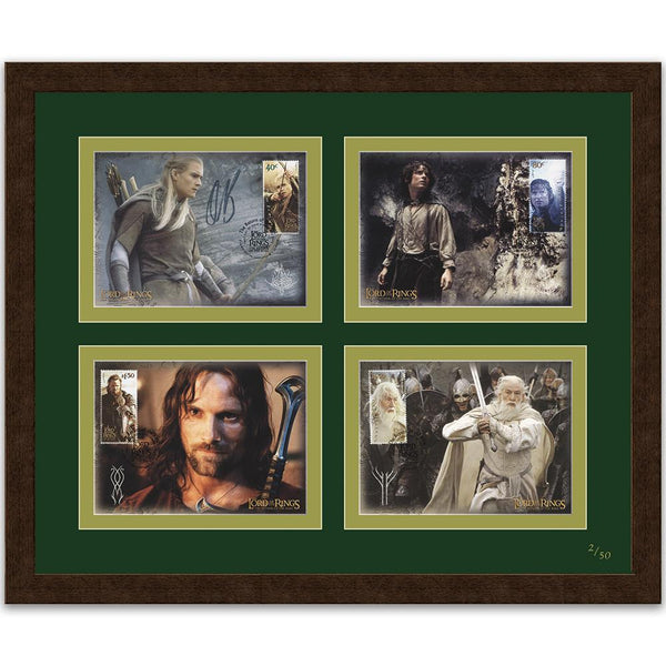 Four maxi cards from New Zealand commemorative The Lord of the Rings trilogy. Legolas card signed by Orlando Bloom. Framed limited edition.