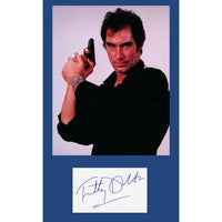 Colour photograph of Timothy Dalton as James Bond, signed.