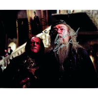 Signed colour photograph of Michael Gambon and David Bradley as their characters, Dumbledore & Argus Filch in the Harry Potter series.