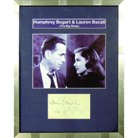 Framed album page signed by Humphrey Bogart and Lauren Bacall.