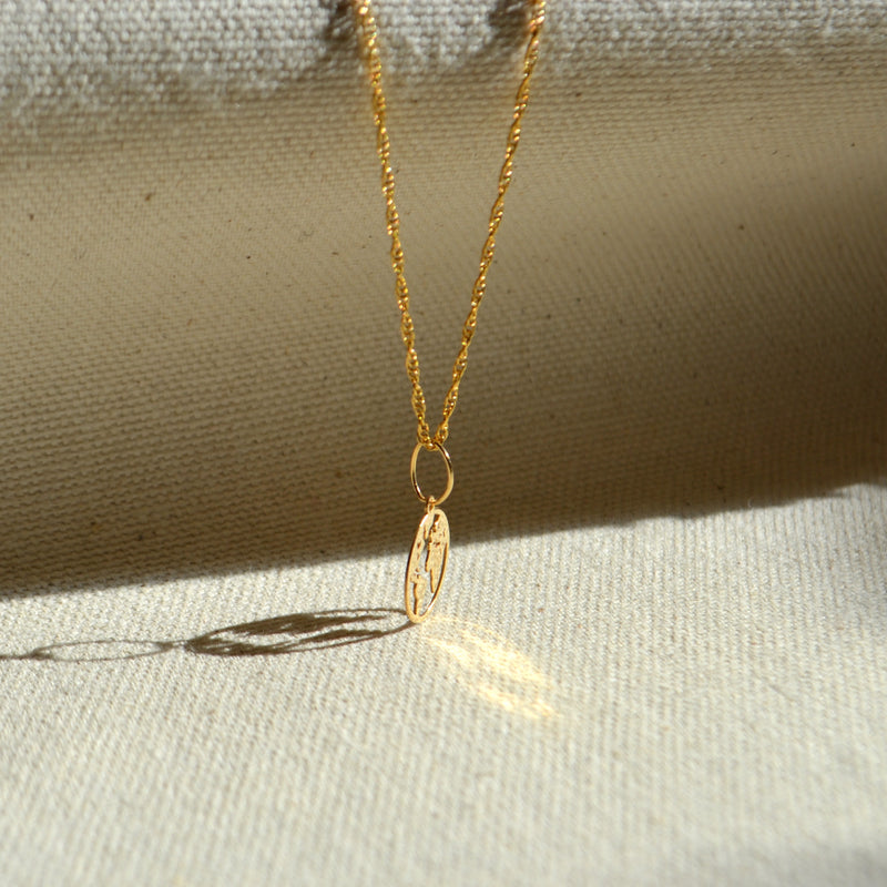 10k solid gold delicate Mother Earth pendant, Safran Collection