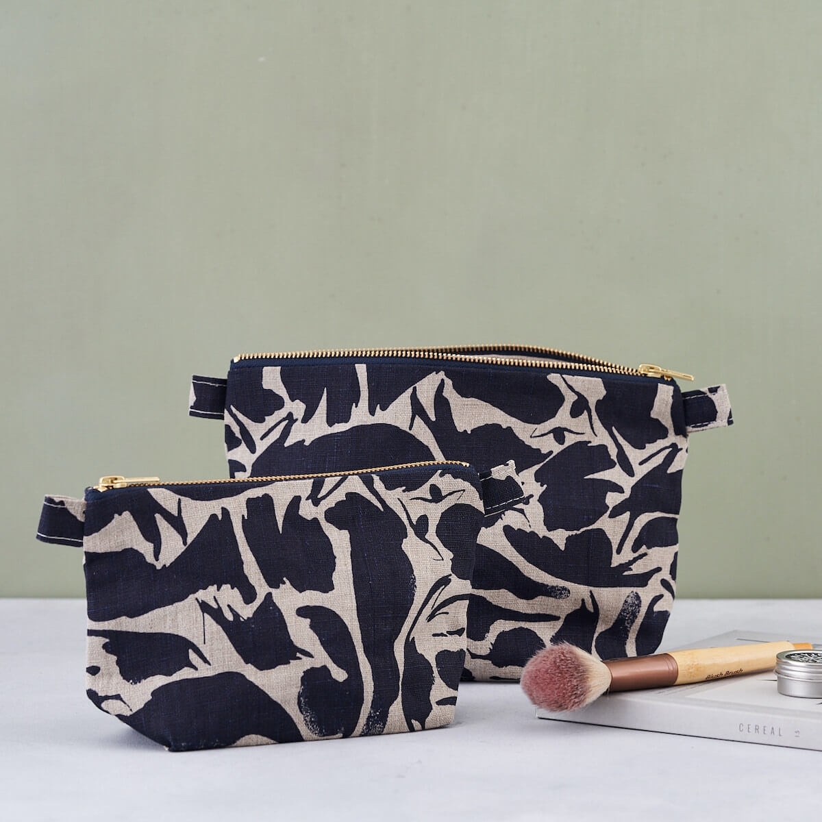 linen toiletry bags with navy print