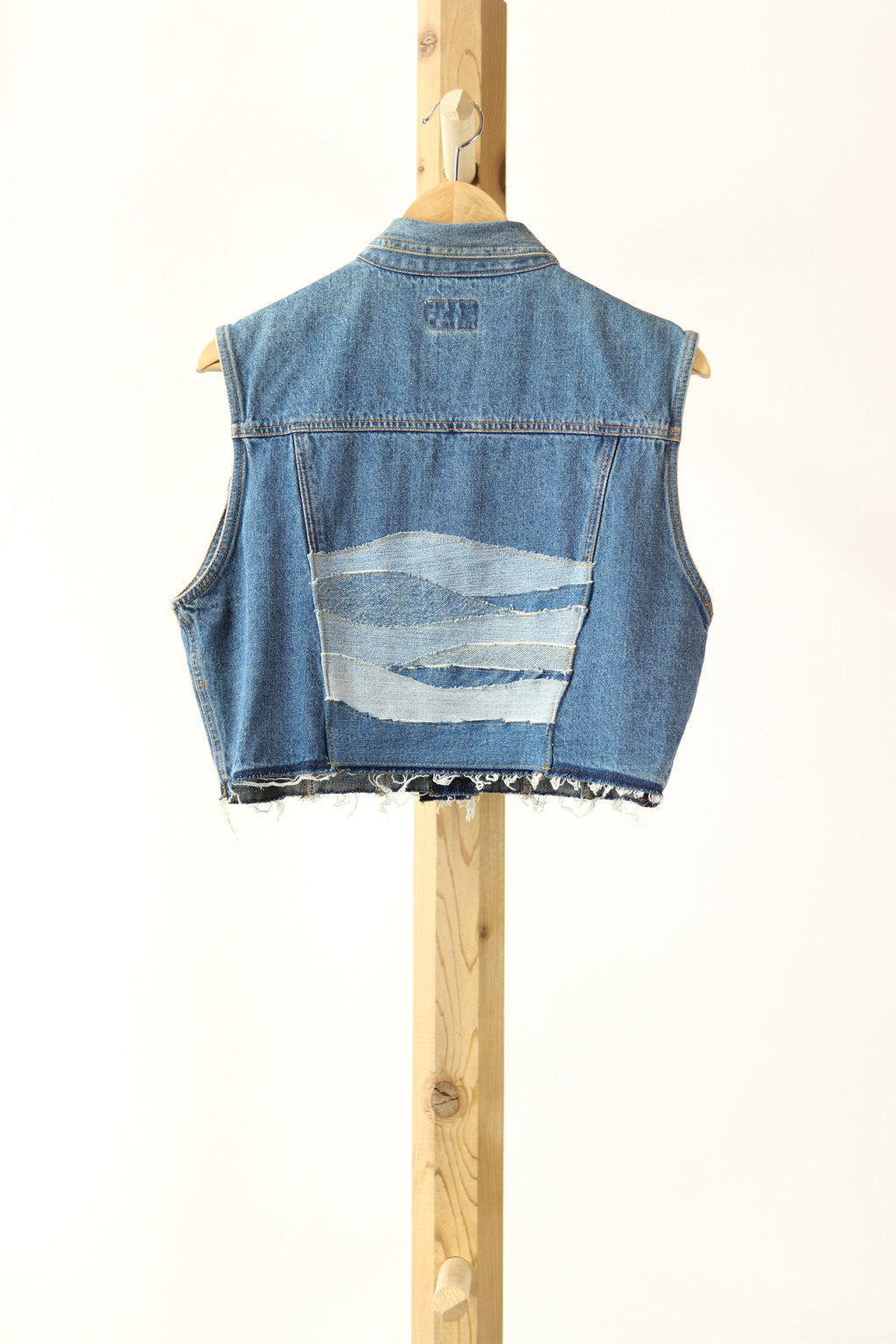 DETAILS :  Description - Jordache Denim Vest Rework in blue with custom wave denim design + frayed hem Colour - Blue Denim Size - L (fits more like a M) Brand - Jordache What it's made of - 100% Cotton Vagabond Reworked piece - Vintage Jordache Denim Vest , Reworked back panel with wave design made from repurposed denim clothing that was deconstructed & reconstructed into this one of a kind design, frayed hem.