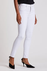 Model wearing WHITE Barbara High-Rise Skinny Ankle Jeans. Model standing in contrapposto... Detail photoshoot. SPRING, 2020 pants - a good neutral basic to wear with almost any top!!! White goes with anything. Raw edge hem. Model on white background. Source: Hudsonjeans.com