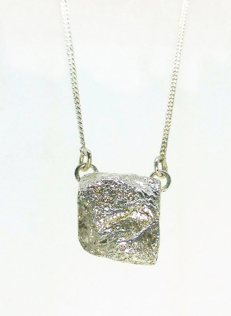 Silver rock textured pendant