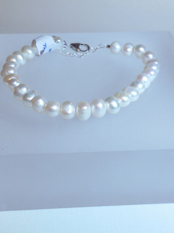 White Freshwater Pearls and Bracelets