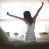Woman waking up and stretching, Improve your morning routine by Phoenix Nutrition,