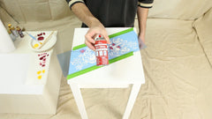 spray and position the stencil template on the table
