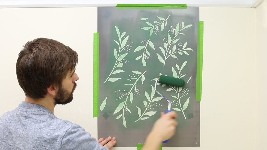 Roll paint through the stencil in several light coats to build the color gradually