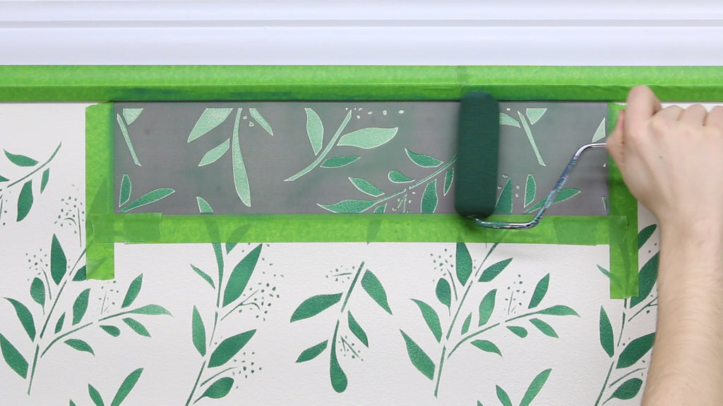 Finish stenciling the design by using the topper stencil along the top of your wall