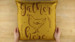 stenciled throw pillow