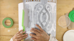 tape the stencil template to the lampshade