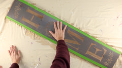 Use repositionable spray adhesive and frog tape to hold the stencil in place