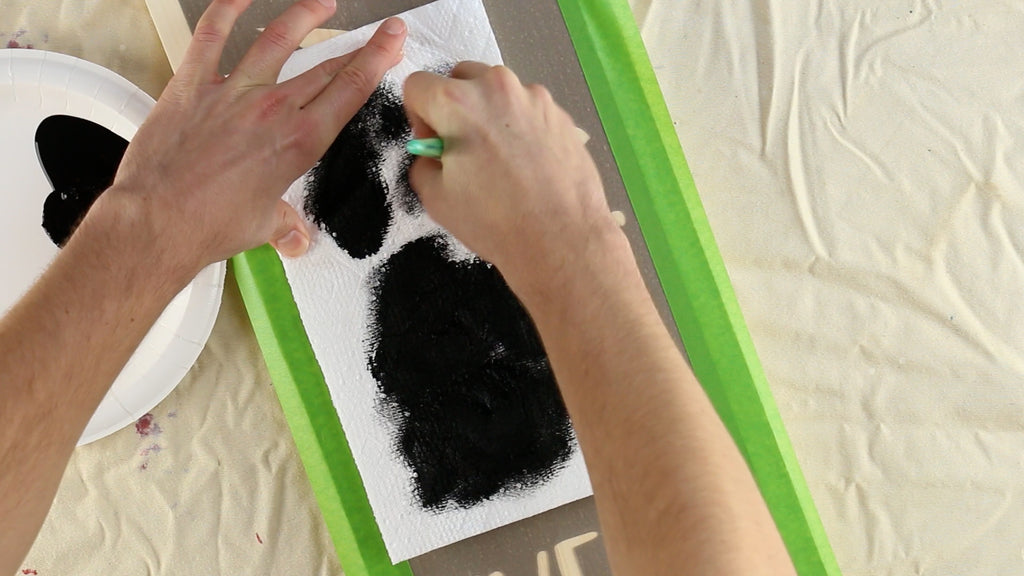 Put paint onto your paper plate, swirl into the stencil brush, and swirl the excess off onto paper towel