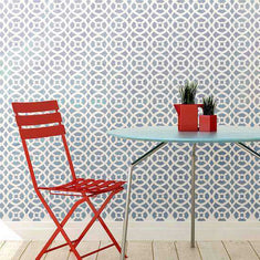 Arabesque Wall Stencils show on Wall with table.