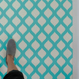 Amina Wall Stencil painted on floor in turquoise.