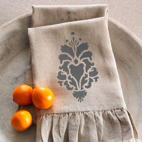 Hillsborough Damask Motif Stencil on a napkin using fabric stencils.