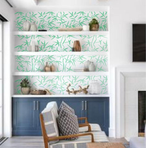 Bamboo Paradise wall stencils painted in bookcase.
