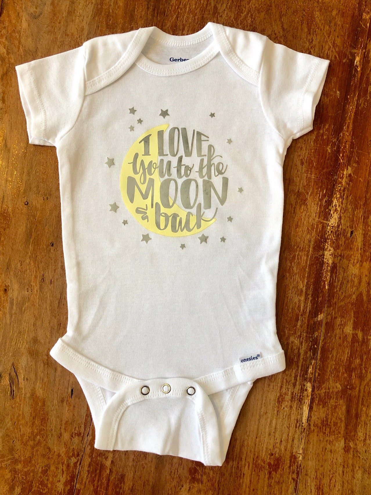 Love you to the moon and back Gerber brand onesie available in sizes from 0-24 months.