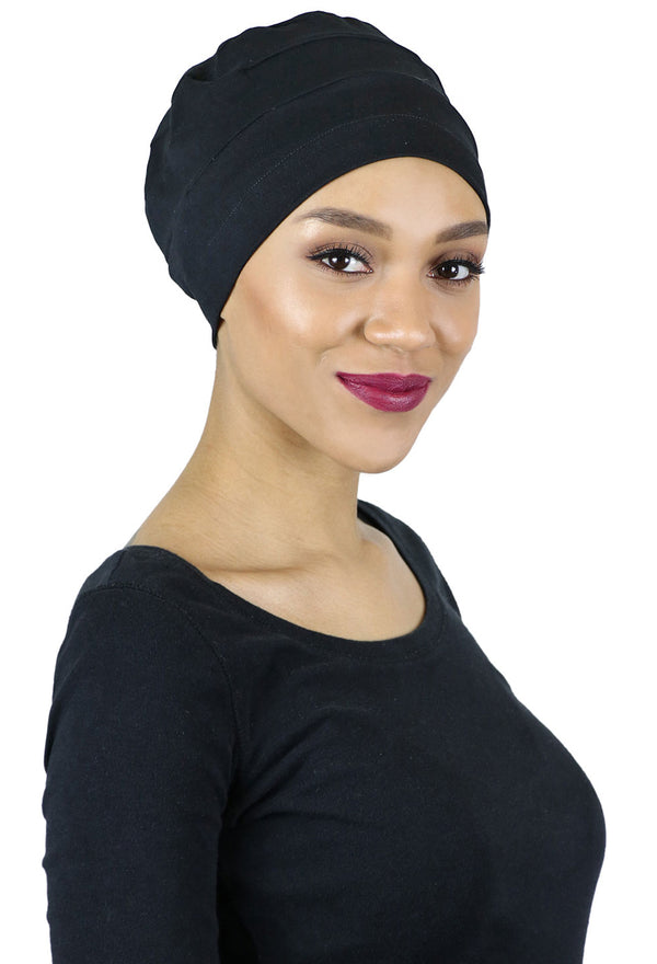 woman wearing black chemo turban cotton chemo headwear