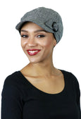 woman wearing black tweed herringbone newsboy hat chemo headwear