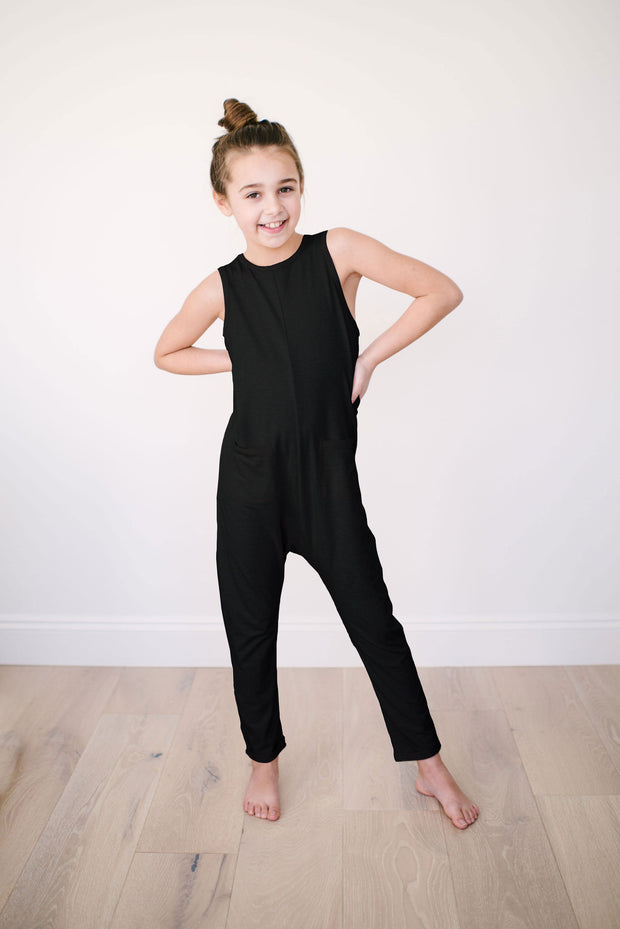 The Mini Saturday Romper, sleeveless black jumpsuit for girls | London is 8yrs wearing a 8/9