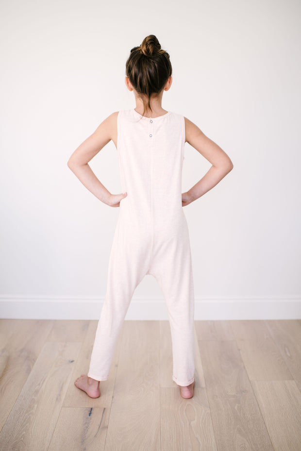 The Mini Saturday Romper, sleeveless pink jumpsuit for girls | London is 8yrs wearing an 8/9