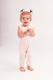 The Mini Saturday Romper, sleeveless black jumpsuit for girls | Frankie is 1.5yrs wearing a 12-18m