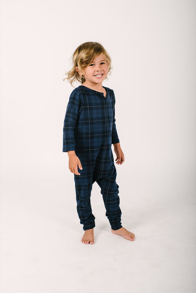 The mini present in plaid Romper | Oliver is wearing size 4/5