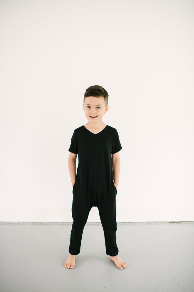 The Mini Sunday Romper, short sleeve jumpsuit for boys | Calum is 6yrs wearing a 6/7