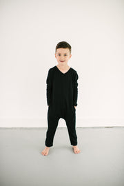 The Mini Friday Romper, long sleeve black jumpsuit for toddlers and kids | Calum is 6yrs wearing a 6/7
