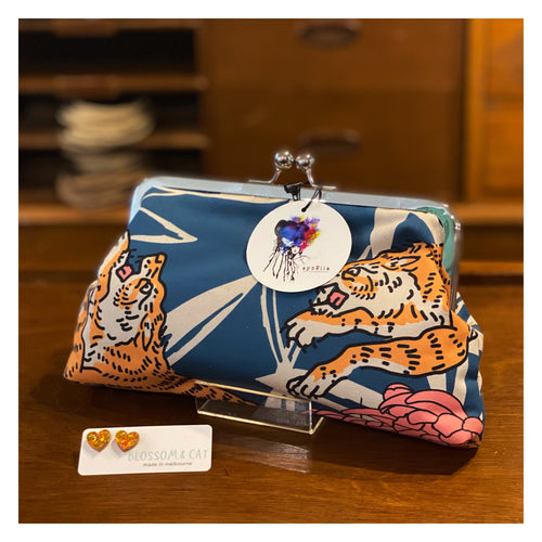 Baskin (tigers!) - Large clutch purse with kisslock clasp and metal frame by Sybella