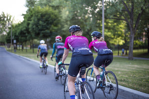 women cyclists riding with Lululemon team
