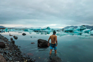 Wim Hof Method review: a man standing on an icy lake