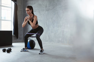 Woman doing resistance band squats
