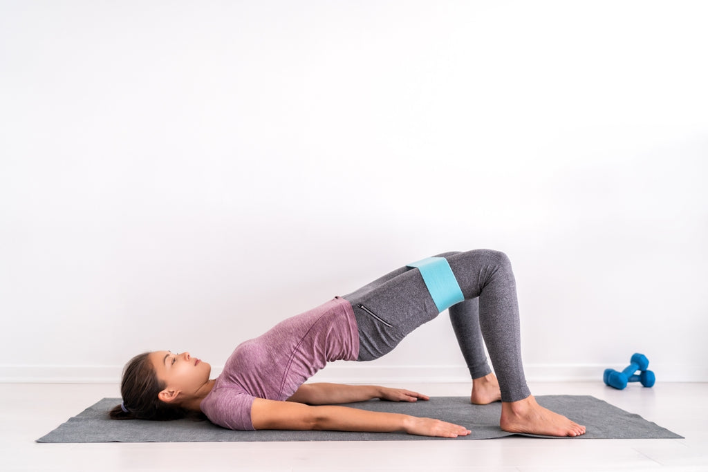 how to get stronger: Woman doing exercises on the floor