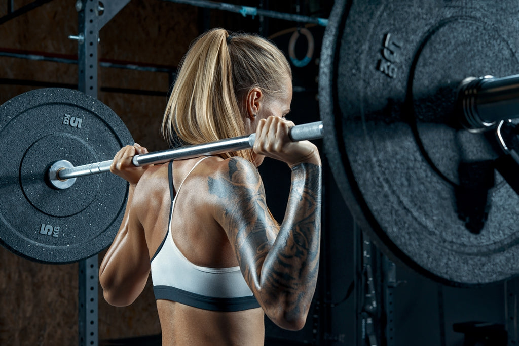 Woman working out using a barbell