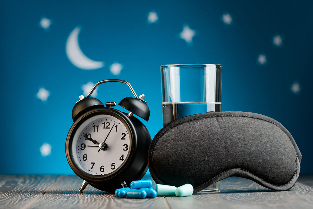 magnesium for sleep: clock, mask and a glass of water