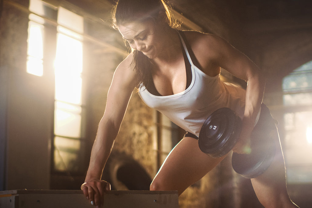 Woman performing a chest and back workout