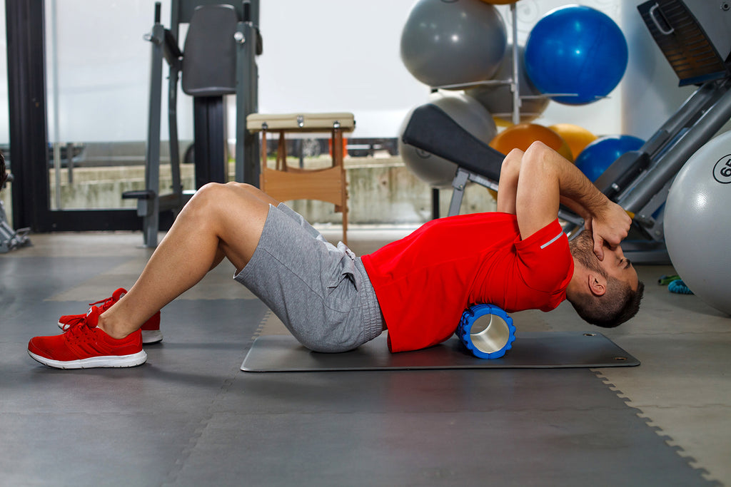 A man doing thoracic spine mobility exercises