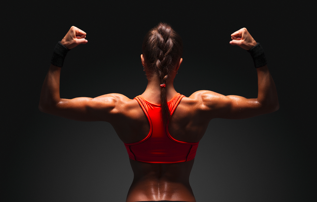 Posterior chain exercises: Woman showing back muscles