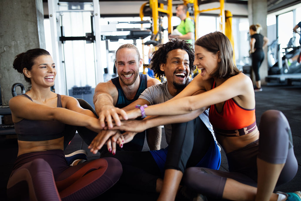 group of people smiling at the gym